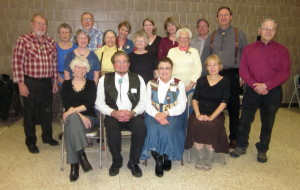 Graduates.  Seated - Kay, Caller Abe and Babe (Carol), and Pam.  Standing - Gary, Mary, Carmen, Bill, Grace, Adrienne, Ruth, Susann, Sherry, Bonnie, Greg, John, and Jim.  Not Pictured - Kristy, Dilly, Jan, and Jessica.