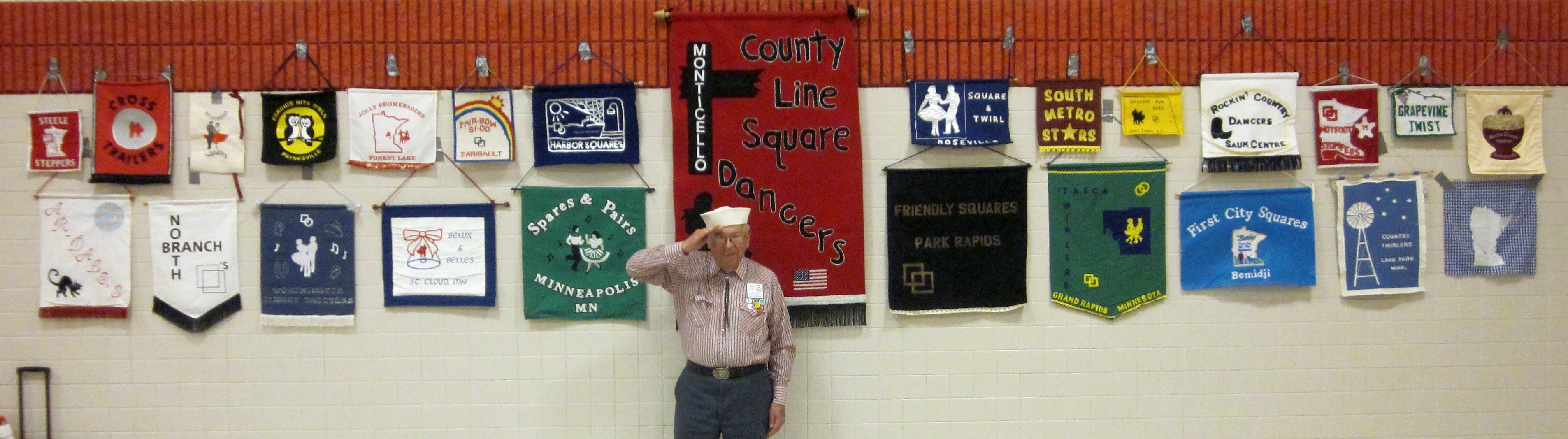 24 Banners on Display, with Willard Rendering the Salute!