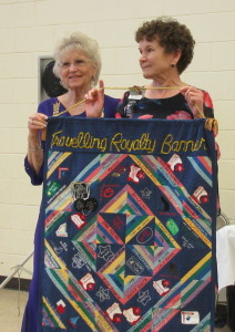 Susie being presented the Travelling Royalty Banner by last year's recipient Evonne Clem.