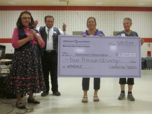 A check for $2,060 (from the March fund-raiser) was presented to the Alzheimer's Association Minnesota-North Dakota.