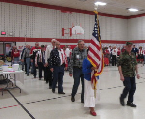 Veterans march with the colors.