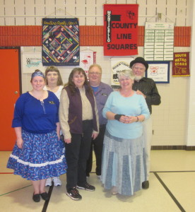 Koronis Nite Owls (with an assist from Jolly Twirlers) claimed a County Line Squares banner.
